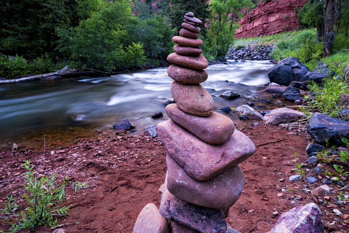 Rock Cairn Along the Shore of the Fryingpan River - Scenic red-rock canyon landscape near Aspen and Basalt, Colorado USA. Balance theme.